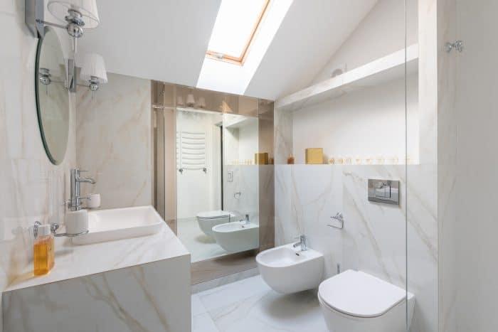 A modern bathroom with bidet and sink